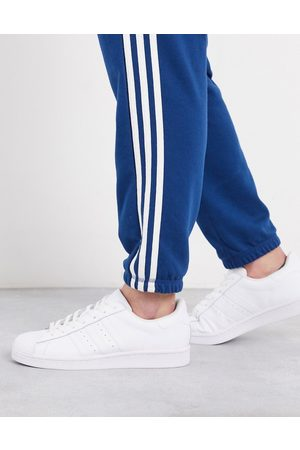 adidas Superstar trainers in triple white