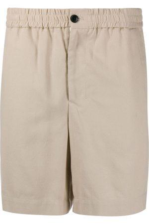 Ami Bermudas con bolsillos laterales
