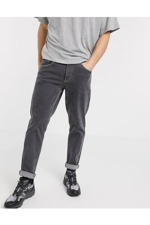 ASOS Stretch tapered jeans in retro black