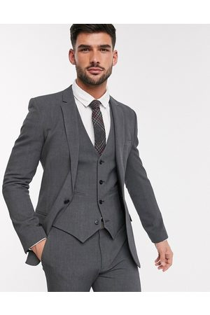 ASOS Super skinny suit jacket in four way stretch in charcoal