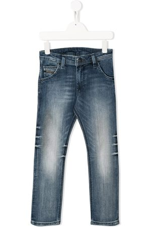 Diesel Jeans tapered con estilo envejecido