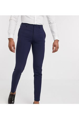 ASOS Tall super skinny suit trousers in four way stretch in navy