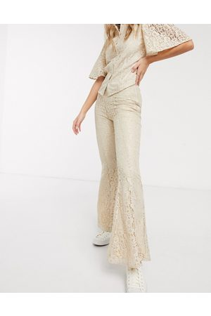 Résumé Resume tawny lace flared trousers in sand