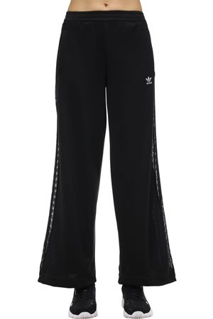 adidas Pantalones De Pierna Ancha Con Bandas Laterales