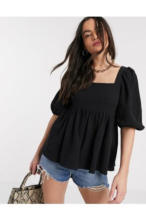 ASOS Textured peplum top with lace up back in Black