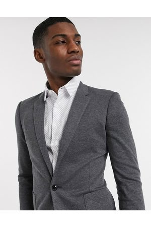 ASOS DESIGN Super skinny jersey blazer in charcoal