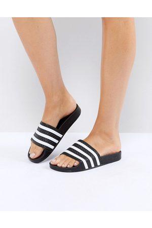 adidas Originals Adilette sliders in black and white