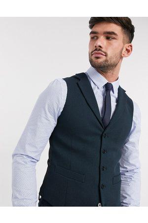 ASOS DESIGN Wedding super skinny suit waistcoat in dark green wool blend twill