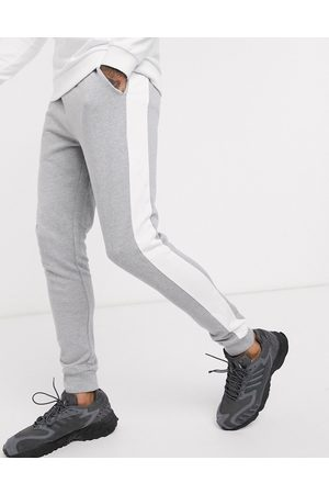 ASOS DESIGN Skinny joggers with side stripe in grey marl