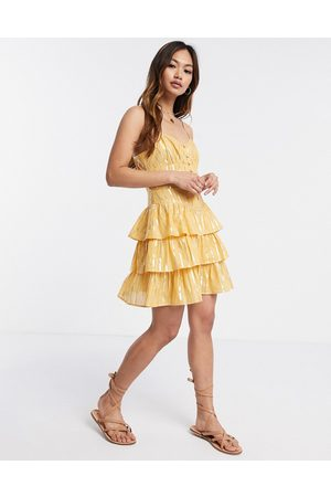 ASOS Mujer Casuales - Button front mini tiered sundress in metallic stripe in mustard