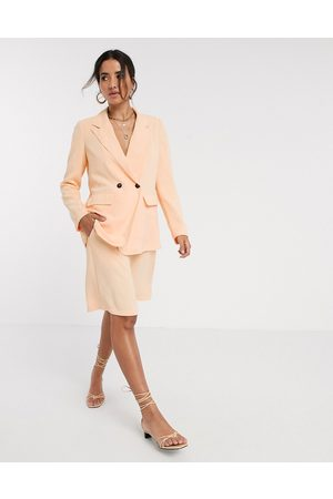 Vero Moda Exclusive tailored city shorts with belted waist in peach