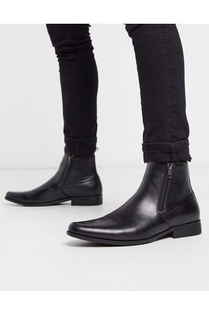 ASOS Chelsea boots in black faux leather with zips