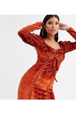 ASOS ASOS DESIGN Petite velvet broderie mini dress with lace up front in rust