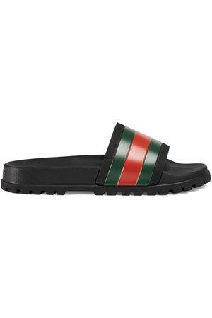 Gucci Flip flops con detalle Web