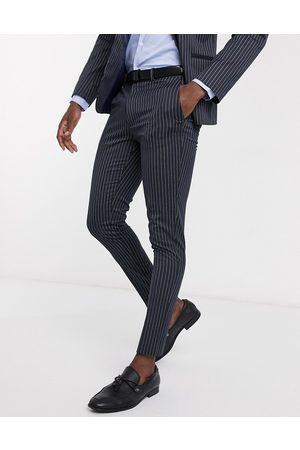 ASOS Wedding super skinny suit trousers in navy pinstripe