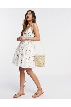 ASOS Tie wrap around crinkle mini sundress in spot print