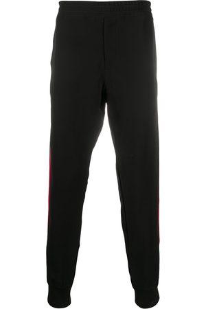 Alexander McQueen Pants con rayas laterales