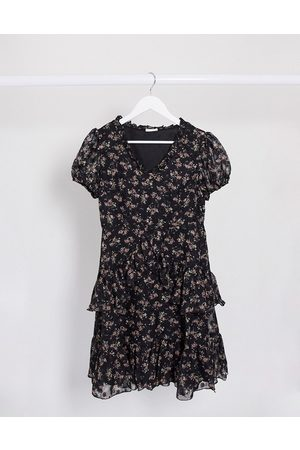 Vila Mini dress with tiered skirt in black ditsy floral
