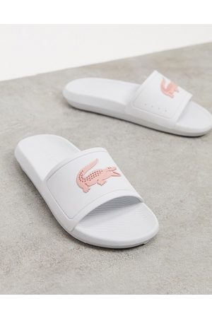 Lacoste Mujer Flip flops - Croco logo slides in white and pink