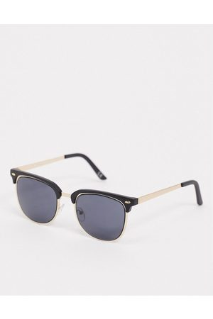 ASOS Retro sunglasses in gold with black brow detail and solid black lens