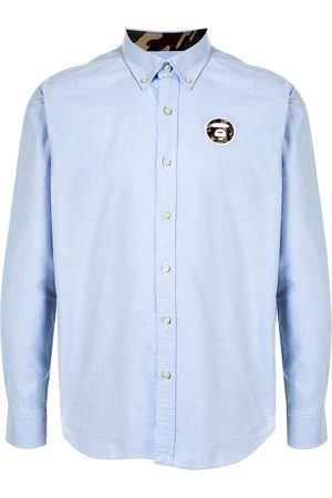 AAPE BY *A BATHING APE® Camisa con rayas laterales