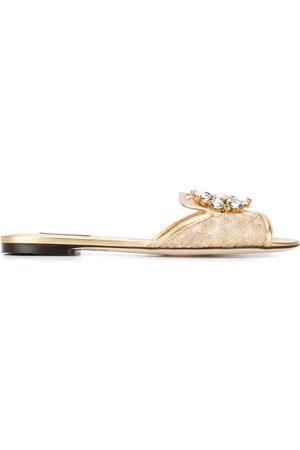 Dolce & Gabbana Slippers de encaje Bianca