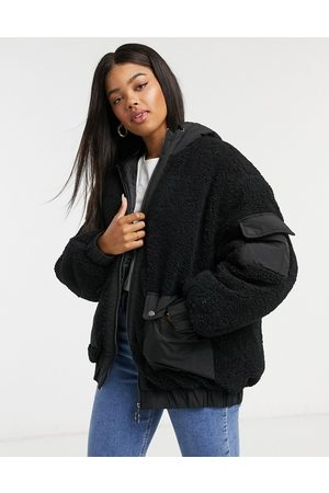 ASOS Fleece patched bomber jacket in black