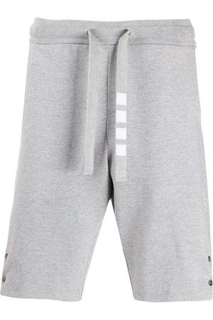 Thom Browne Hombre Shorts - Shorts deportivos con abertura lateral