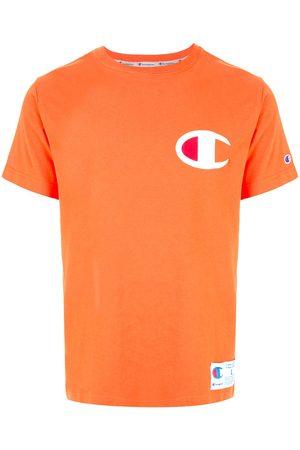 Champion Playera con parche del logo