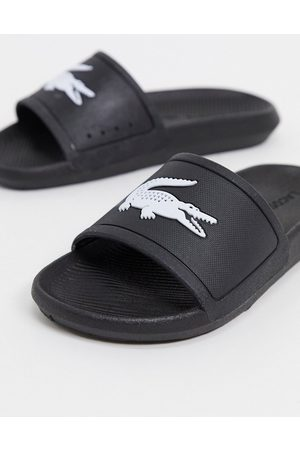 Lacoste Croco logo slides in black and white