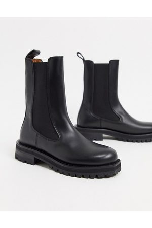 & OTHER STORIES Leather tall chunky flat boots in black