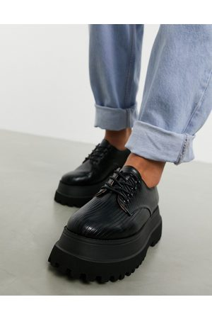 ASOS Marcy chunky lace up flat shoes in black lizard