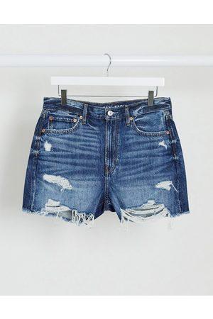 AMERICAN EAGLE 90's boyfriend mid length denim short in dark wash blue