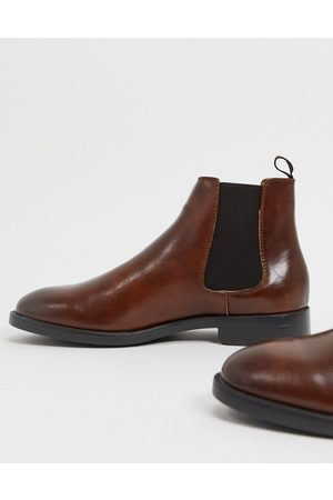 ASOS Chelsea boots in brown faux leather with black sole