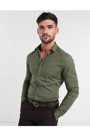 New Look Long sleeve muscle fit poplin shirt in khaki
