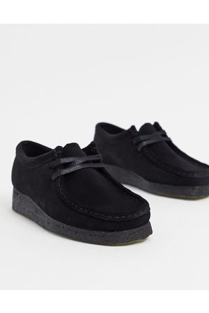 Clarks Wallabee flat shoes in black suede