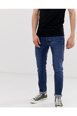 Jack & Jones Intelligence Glenn slim tapered fit jeans in mid blue