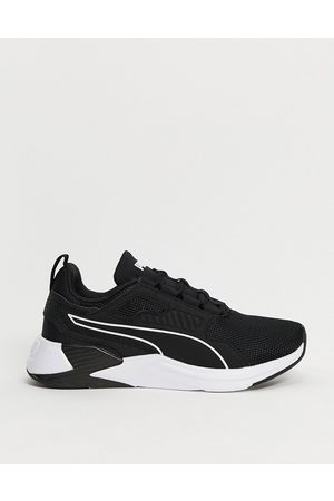 PUMA Mujer Ropa deportiva - Training Disperse XT trainers in black