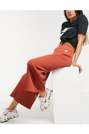Nike Ribbed high waist wide leg joggers in rust