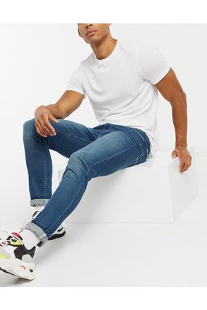 ASOS Skinny jeans in mid wash blue tint