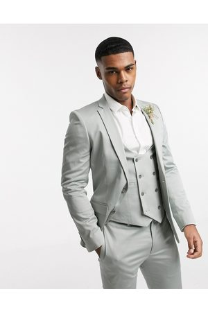 ASOS Wedding super skinny suit jacket in stretch cotton in dusky green