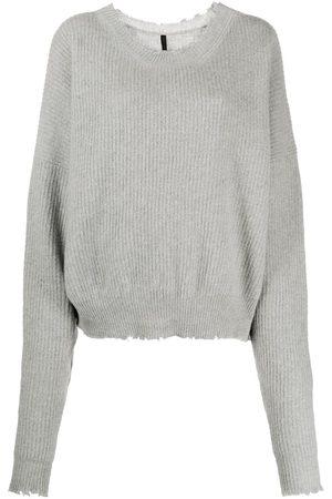 Unravel Project Suéter tejido holgado