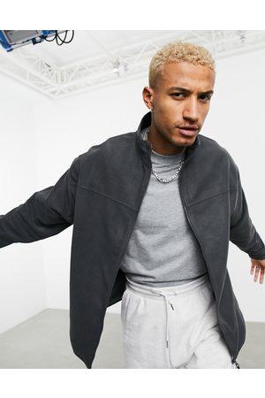 ASOS Oversized polar fleece track jacket in charcoal grey