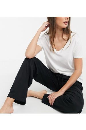 ASOS ASOS DESIGN Tall mix & match straight leg jersey pyjama trouser in black