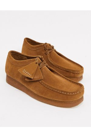 Clarks Wallabee shoes in tan suede