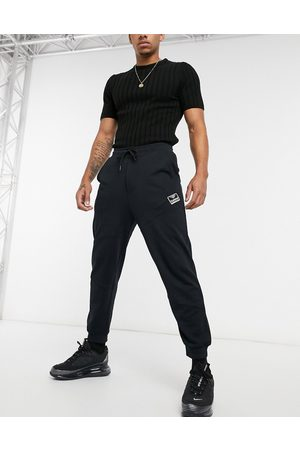 Hummel Small logo joggers in black