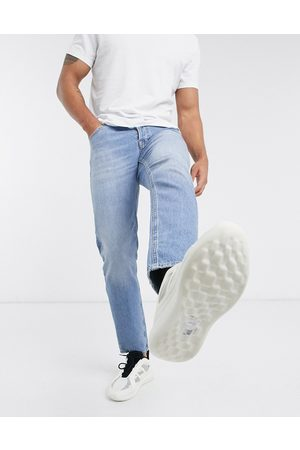 ASOS Stretch tapered jeans in vintage light wash blue