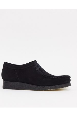 Clarks Wallabee shoes in black suede