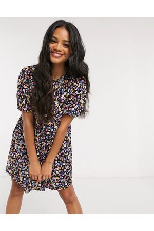 ASOS Mini smock dress in black base floral print