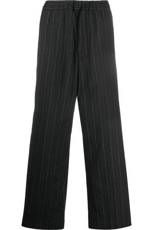 JUUN.J Pantalones anchos con estampado a rayas diplomáticas